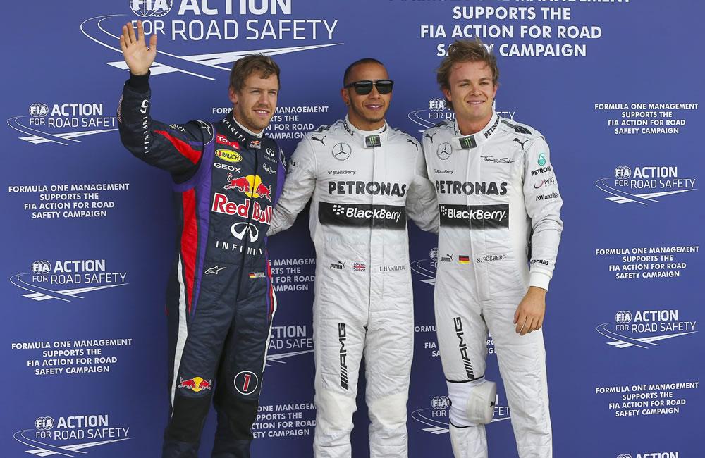 El piloto británico Lewis Hamilton, el alemán Nico Rosberg y Sebastián Vettel durante la clasificación del Gran Premio de Gran Bretaña. EFE