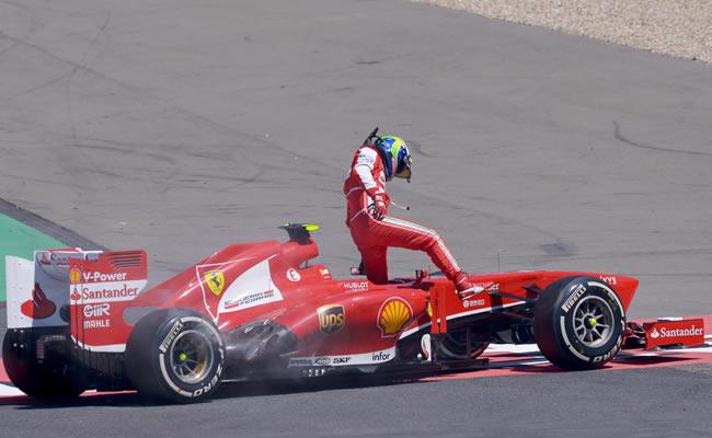 El piloto brasileño de Ferrari, Felipe Massa, se retira del Gran Premio de Alemania. EFE