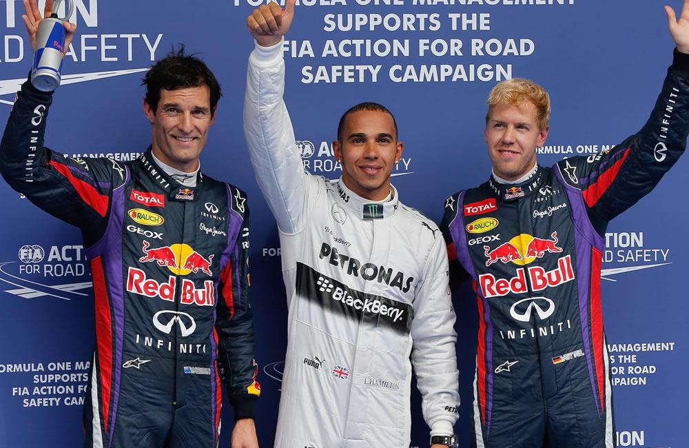 Los pilotos de Fórmula 1, el británico Lewis Hamilton, el australiano Mark Webber y Sebastián Vettel. EFE