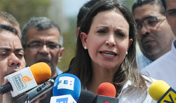 María Corina Machado dice que volverá a Venezuela a su cargo