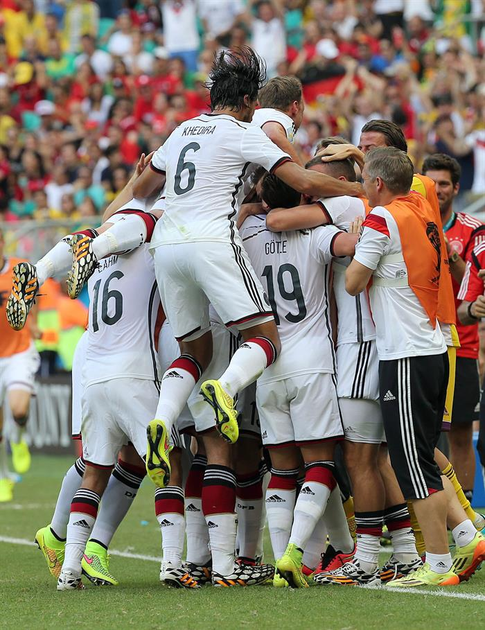 German players celebrate after Mats Hummels scored the 2-0 in action during the FIFA World Cup 2014 group G. EFE
