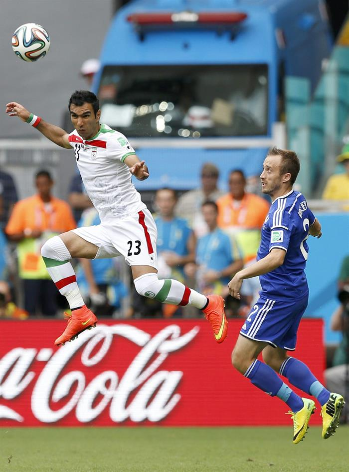 Mehrdad Pooladi (L) of Iran in action with Avdija Vrsaljevic of Bosnia-Herzegovina during the FIFA World Cup 2014 group F. EFE