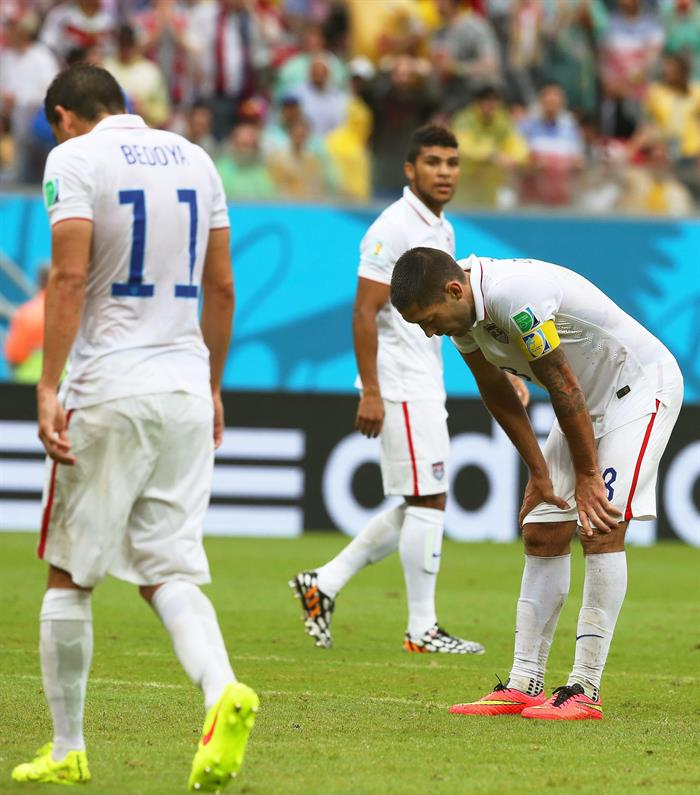 US players Clint Dempsey (R) and Alejandro Bedoya (L) show their dejection during the FIFA World Cup 2014 group G. EFE