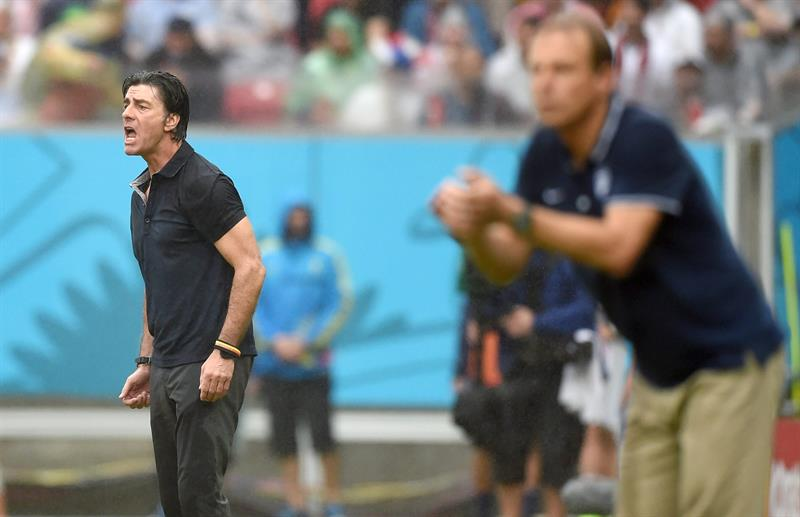 Germany's head coach Joachim Loew (L) and USA's German head coach Juergen Klinsmann stand on the sideline during the FIFA World Cup 2014 group G. EFE