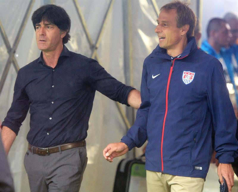 Germany's head coach Joachim Loew (L) and USA's German head coach Juergen Klinsmann (R) enter the pitch prior the FIFA World Cup 2014 group G. EFE
