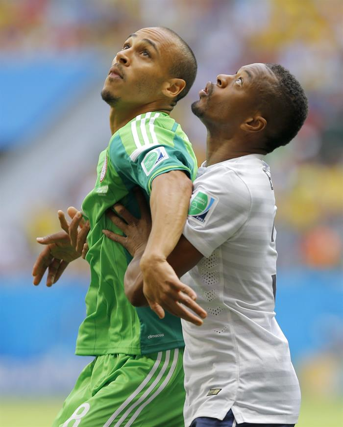 Patrice Evra (R) of France in action with Peter Odemwingie of Nigeria during the FIFA World Cup 2014. EFE