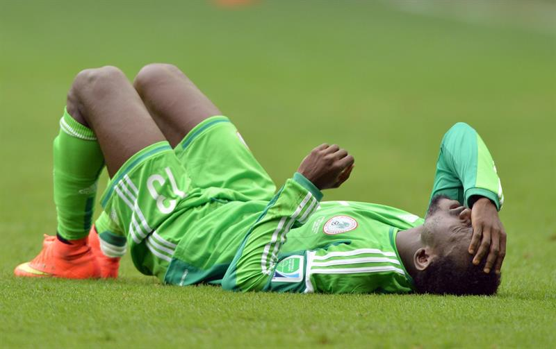 Nigeria's Juwon Oshaniwa lies on the pitch during the FIFA World Cup 2014 round of 16 match between France and Nigeria at the Estadio Nacional in Brasilia. EFE