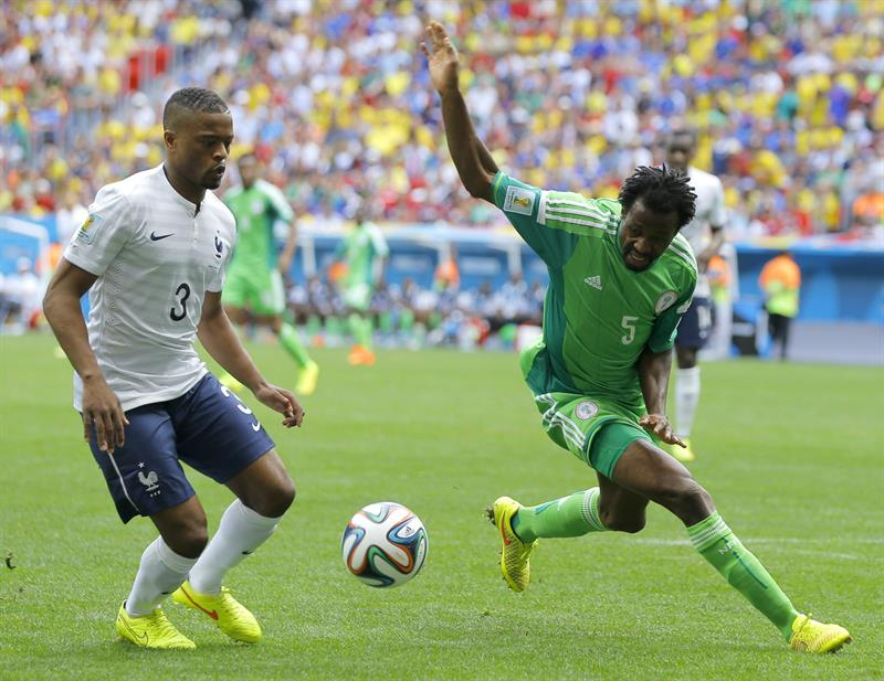 Patrice Evra (L) of France in action with Efe Ambrose of Nigeria during the FIFA World Cup 2014. EFE