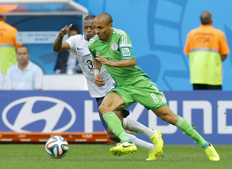 Patrice Evra (L) of France in action with Peter Odemwingie of Nigeria during the FIFA World Cup 2014. EFE