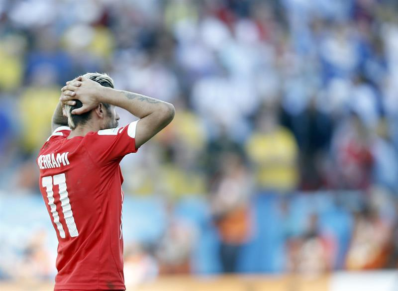 Valon Behrami of Switzerland reacts after Angel di Maria scored the winning goal during the FIFA World Cup 2014. EFE