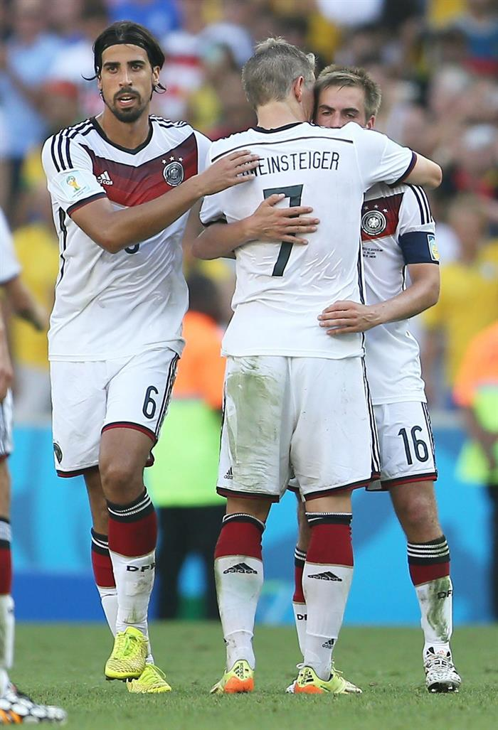 Germany's Sami Khedira (L-R), Bastian Schweinsteiger, and Philipp Lahm celebrate winning after the FIFA World Cup 2014. EFE