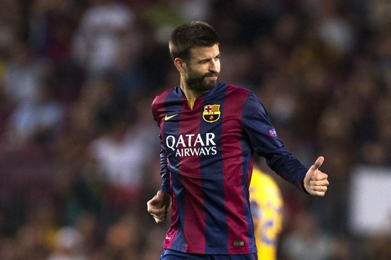 El defensa del FC Barcelona Gerard Piqué celebra el gol que acaba de marcar, el primero del Barsa ante el Apoel. Foto: EFE