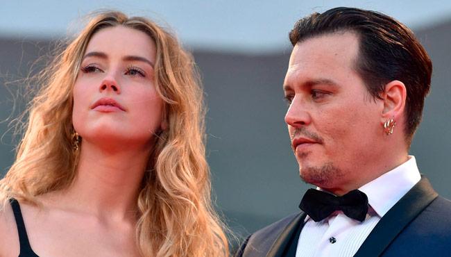 La actriz Amber Head (i) y a su marido, el actor Johnny Depp (d). Foto: EFE