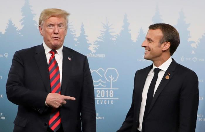El presidente de Estados Unidos, Donald Trump, bromea con su homólogo francés, Emmanuel Macron, el 8 de junio de 2018 en La Malbaie, Canadá. Foto. AFP.