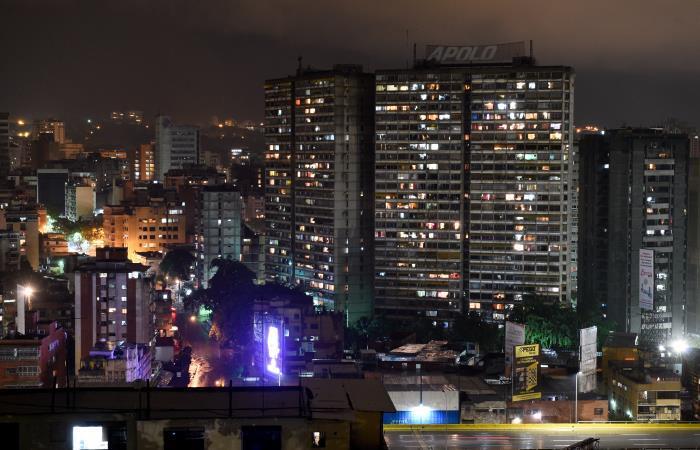 La viviendas en Caracas abandonadas y éxodo de migrantes se eleva en la región. Foto: AFP.